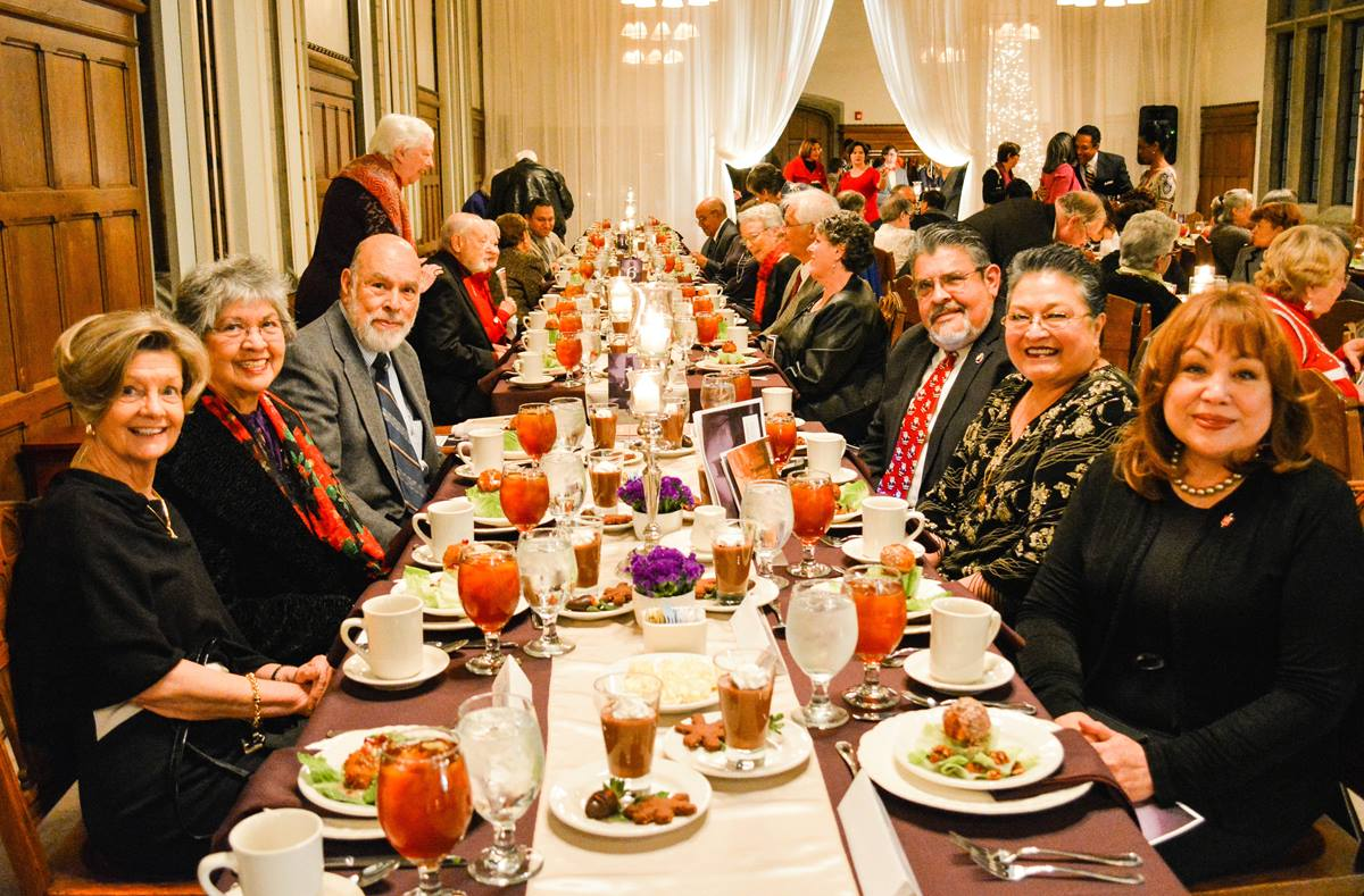 (From left) Jane Bucher, Pauline Alvirez, David Alvirez, Raul Alegria, Bilha Alegria, Bishop Minerva Carcaño are a few of the attendees of the Dec. 6 awards dinner at Scarritt Bennett.