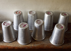 Numbered cups line a shelf at the orphanage.
