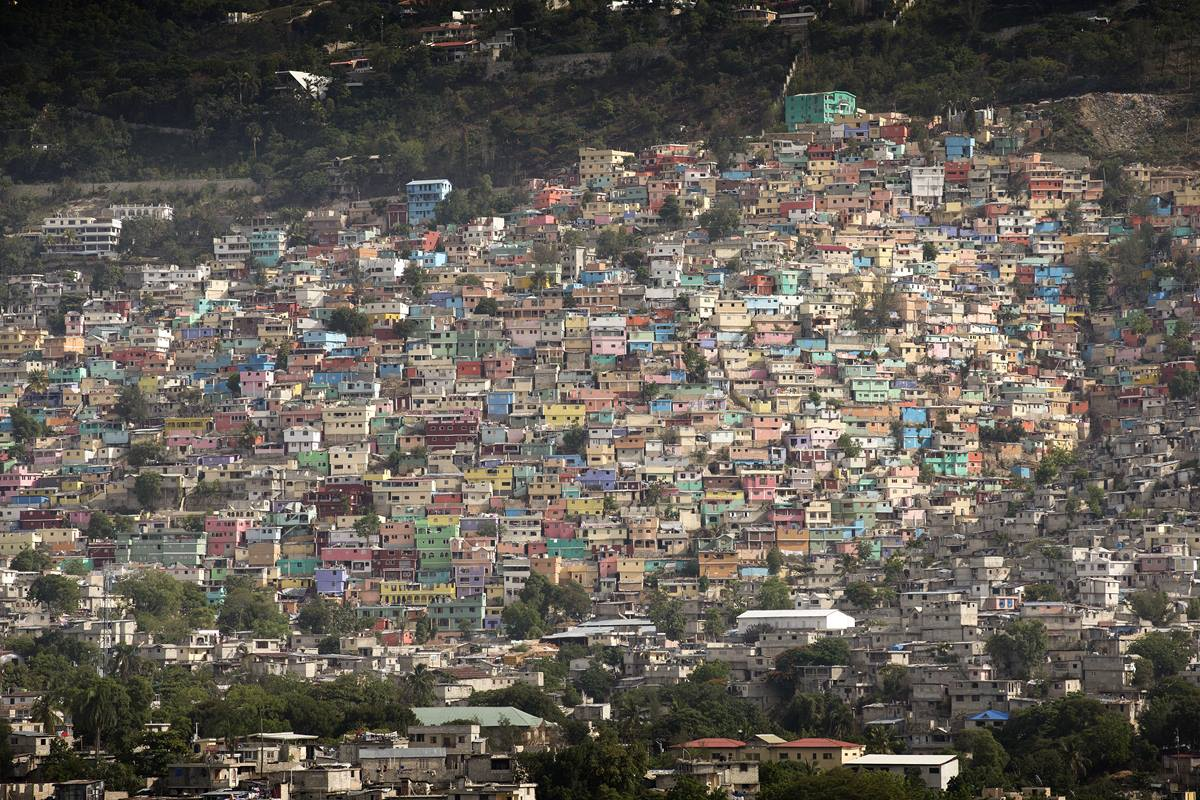 Pastel-colored homes in the Jalousie neighborhood line a hill overlooking Port-au-Prince, Haiti. Photo by Mike DuBose, UMNS