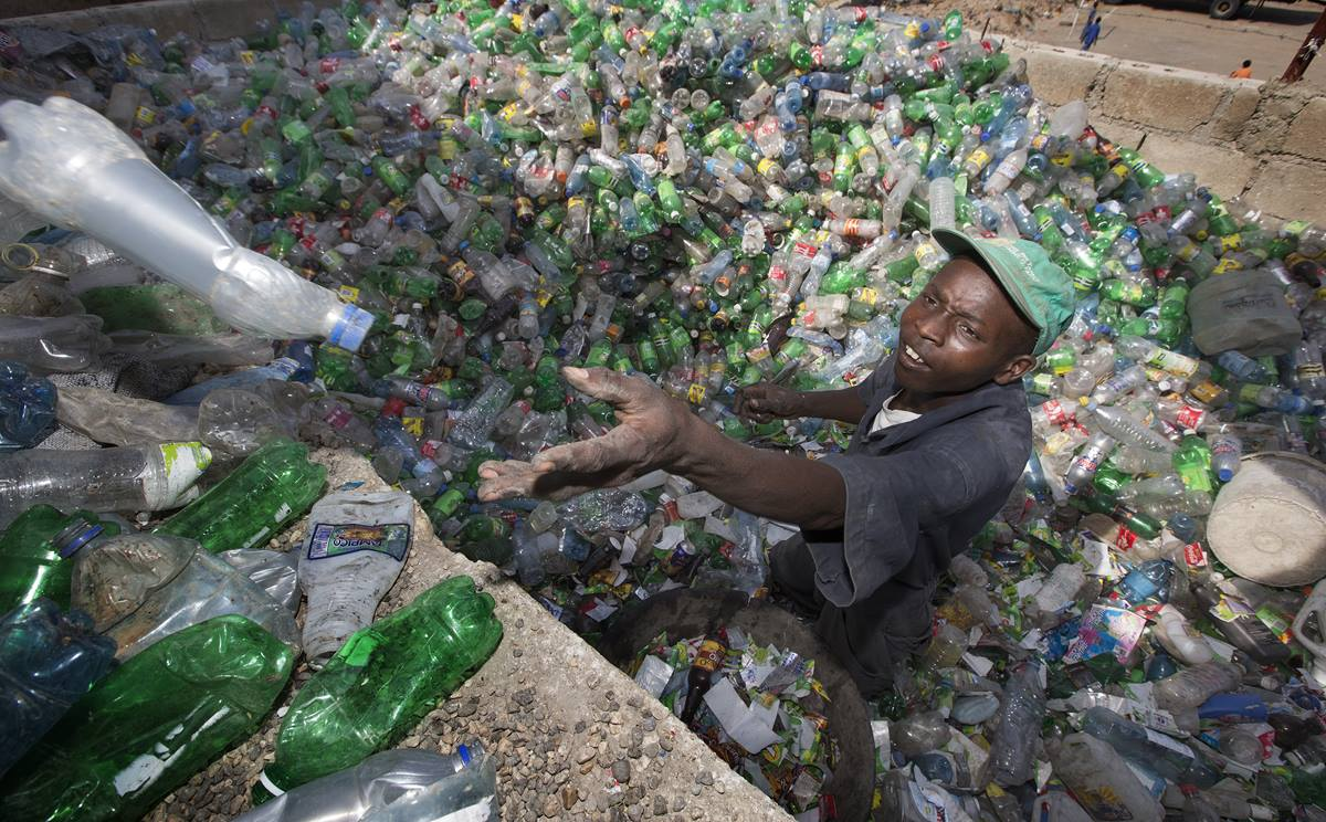 Janvier Jackson sorts plastic bottles for a recycling program sponsored in part by the United Methodist Committee on Relief in Port-au-Prince, Haiti. The program will help reduce solid waste and provide income to collectors and recycling center employees. Photo by Mike DuBose, UMNS