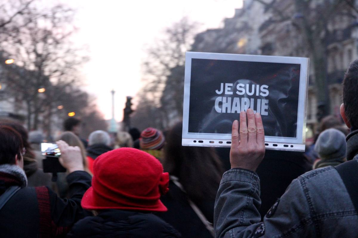 """Parisians gather in solidarity holding signs reading, """"Je suis Charlie."""" Photo by Maya-Anaïs Yataghène, flickr creative commons."""