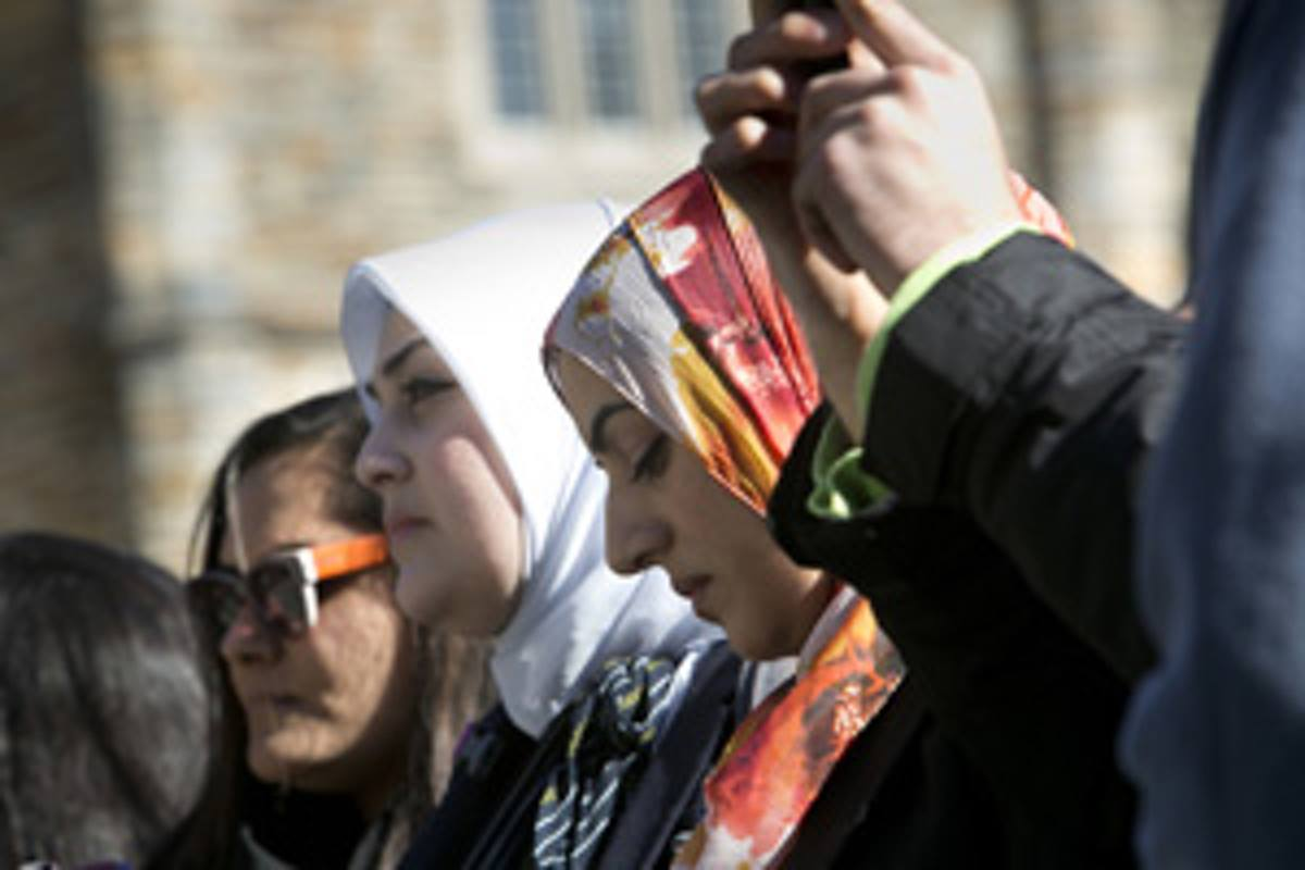 Muslim students at Duke University have used the basement of Duke Chapel for years for prayer services. They gathered outside the chapel on January 16, 2015, for the adhan, or call to prayer. Duke first agreed to let the students do the adhan from the chapel bell tower, but reversed the decision. Photo by Megan Morr, © Duke Photography