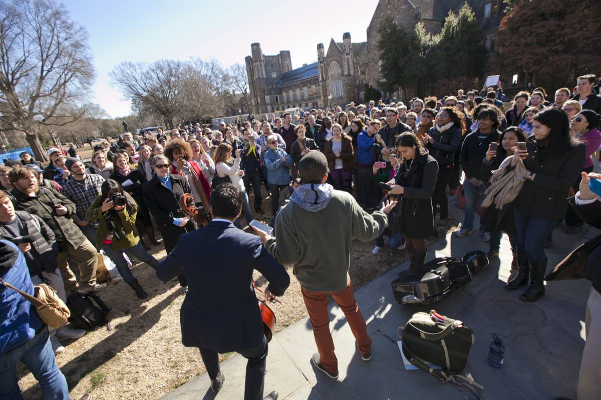 Duke University students Matthew Bunyi (left)  and Richard Phillips led a crowd outside Duke Chapel in song before the start of the adhan, the Muslim call to prayer, on January 16, 2015. University officials cancelled plans to have the call to prayer offered from the chapel's bell tower, but allowed it from the chapel's steps. Photo by Megan Morr, © Duke Photography