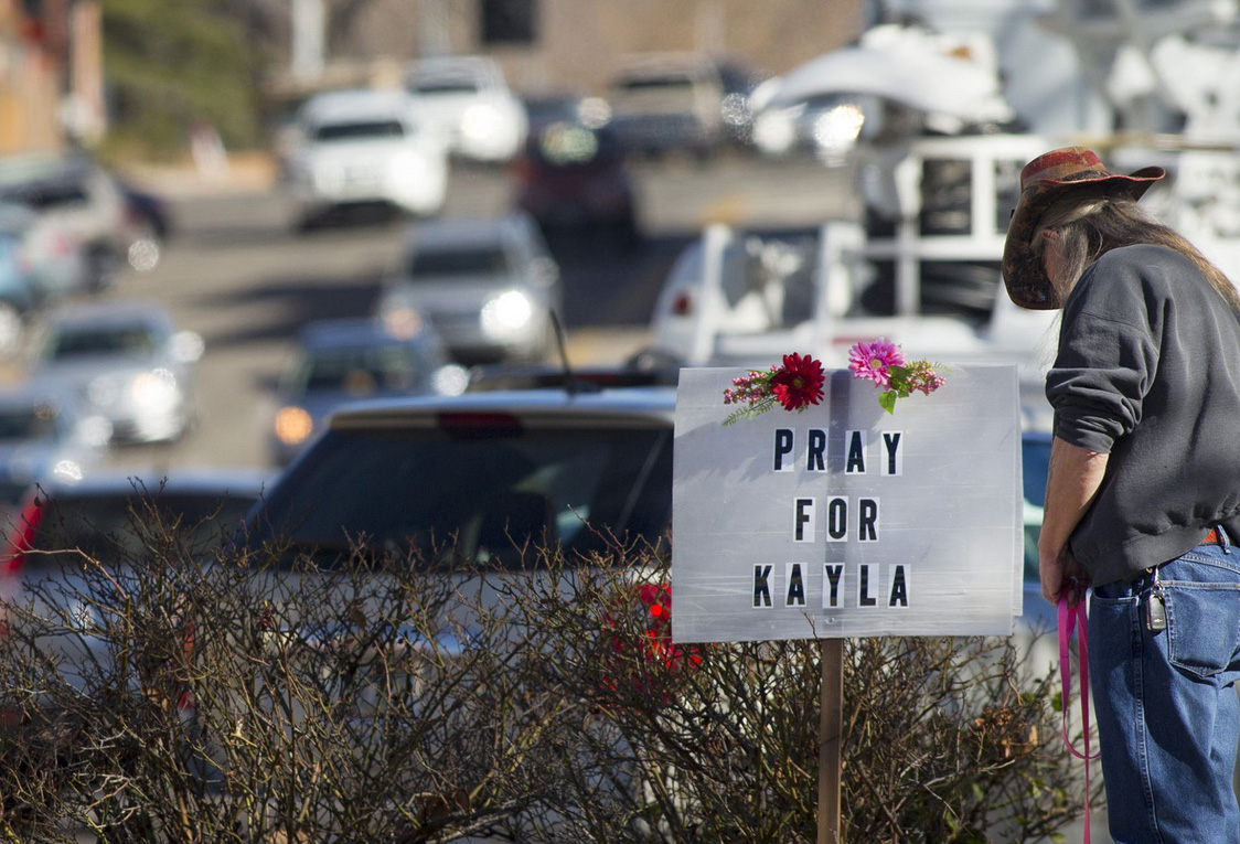 A sign asking people to pray for Kayla Mueller, an ISIS held Arizona aid worker, is posted in downtown Prescott, Ariz.
