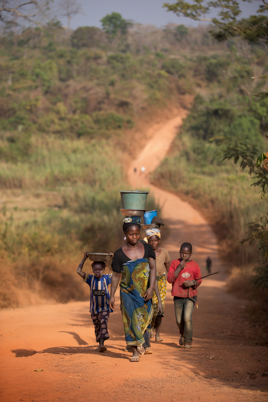 A family makes its way along the road outside Sipilou, near the border with Guinea.