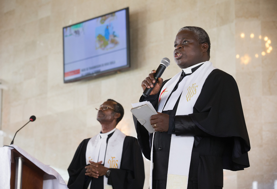 The Rev. Marcel Sachou (right) uses a video presentation to describe ways to help parishioners prevent Ebola at Temple Bethel United Methodist Church in Abobo-Baoule, outside Adidjan. At left is the Rev. Esaïe M'Ye Gnamien, the district superintendent.