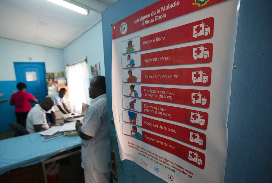 A poster detailing the signs of Ebola is taped to a door at Dabou Methodist Hospital in Dabou, hub of the church's healthcare system in this West African nation.