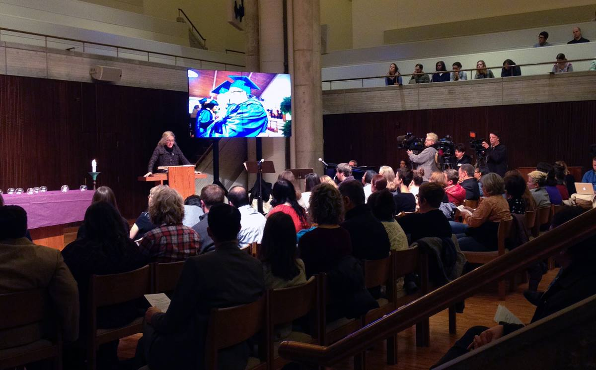 """Candler School of Theology holds a vigil for """"Life, Light & Solidarity"""" for Kelly Gissendaner at Cannon Chapel. Gissendaner is facing execution in Georgia. At the podium is Elizabeth Bounds."""