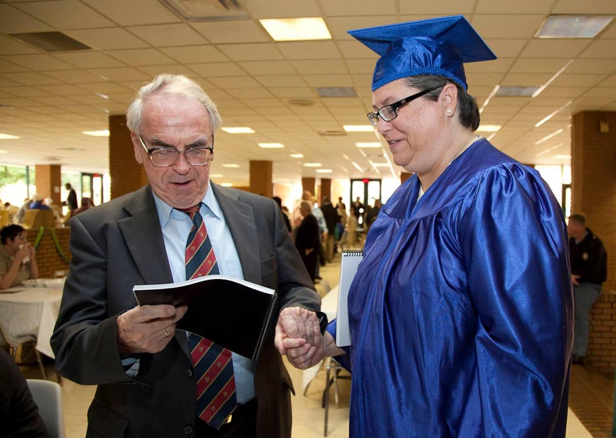 Jürgen Moltmann (left), a German theologian, who became friends with Kelly Gissendaner and exchanged letters with her over the years attends her 2011 graduation ceremony at Arrendale State Prison.