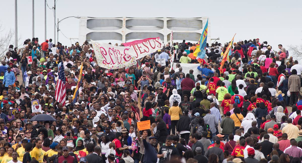 """Marchers cross the Edmund Pettus Bridge in Selma, Ala., during the 50th anniversary observance of the """"Bloody Sunday"""" protest march seeking voting rights for African Americans. Photo by Mike DuBose, UMNS"""