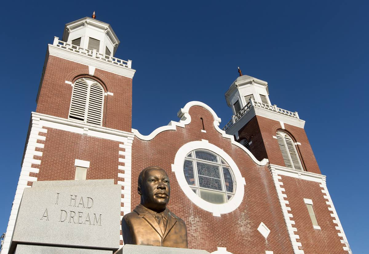 """A bust of the Rev. Martin Luther King Jr. stands outside Brown Chapel African Methodist Episcopal Church in Selma, Ala. The church served as a staging area for voting rights protesters who were beaten by police during the """"Bloody Sunday"""" march in 1965. Photo by Mike DuBose, UMNS"""