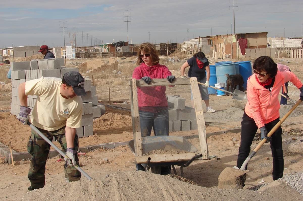 Mission team members from Suncreek United Methodist Church sift out rocks as part of the mortar-making process. They spent three days building a cinder-block home for the Quinoñes family of Ciudad Juárez, Mexico. Photo by Sam Hodges, UMNS