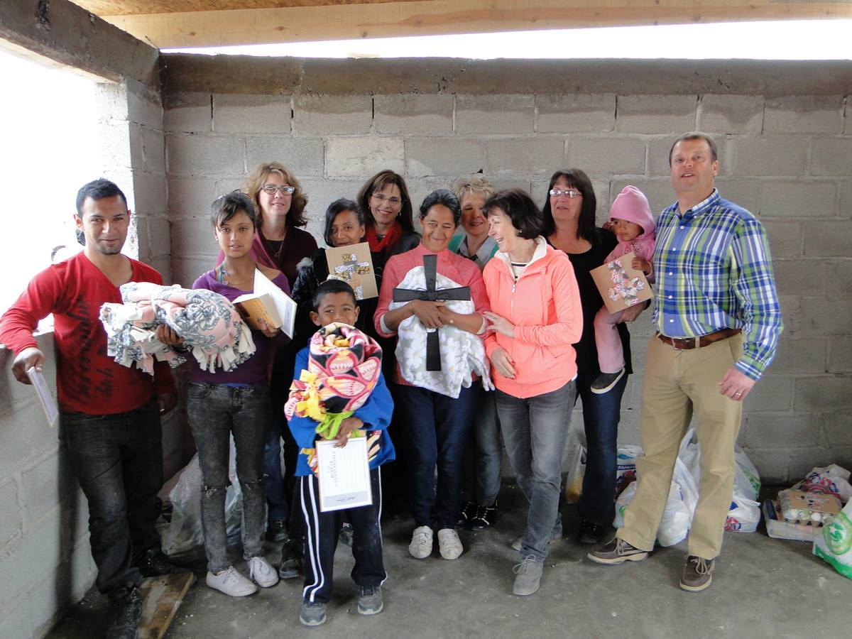 Mission team members from Suncreek United Methodist Church helped build a cinder-block home last month for the Quinoñes family of Ciudad Juárez, Mexico, and posed with the family after a dedication service. Photo courtesy Janet Hunt, Suncreek United Methodist Church.