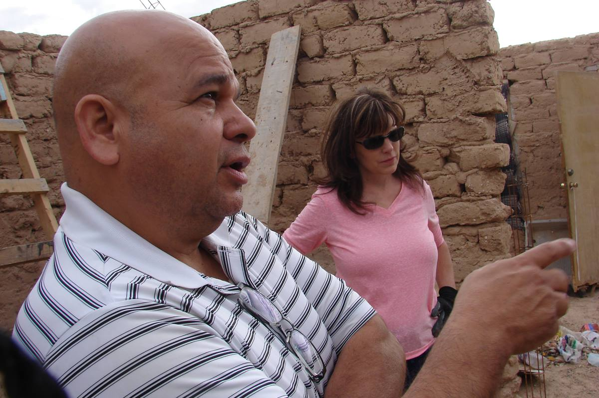 The Rev. Jose Luis Portillo (left) is a Christian Missionary Alliance pastor and executive director of Proyecto Abrigo, which relies on United Methodist groups to help build homes for the needy in Ciudad Juárez, Mexico. With him is Janet Hunt, director of community ministries at Suncreek United Methodist Church and chair of the Proyecto Abrigo board. Photo by Sam Hodges, UMNS