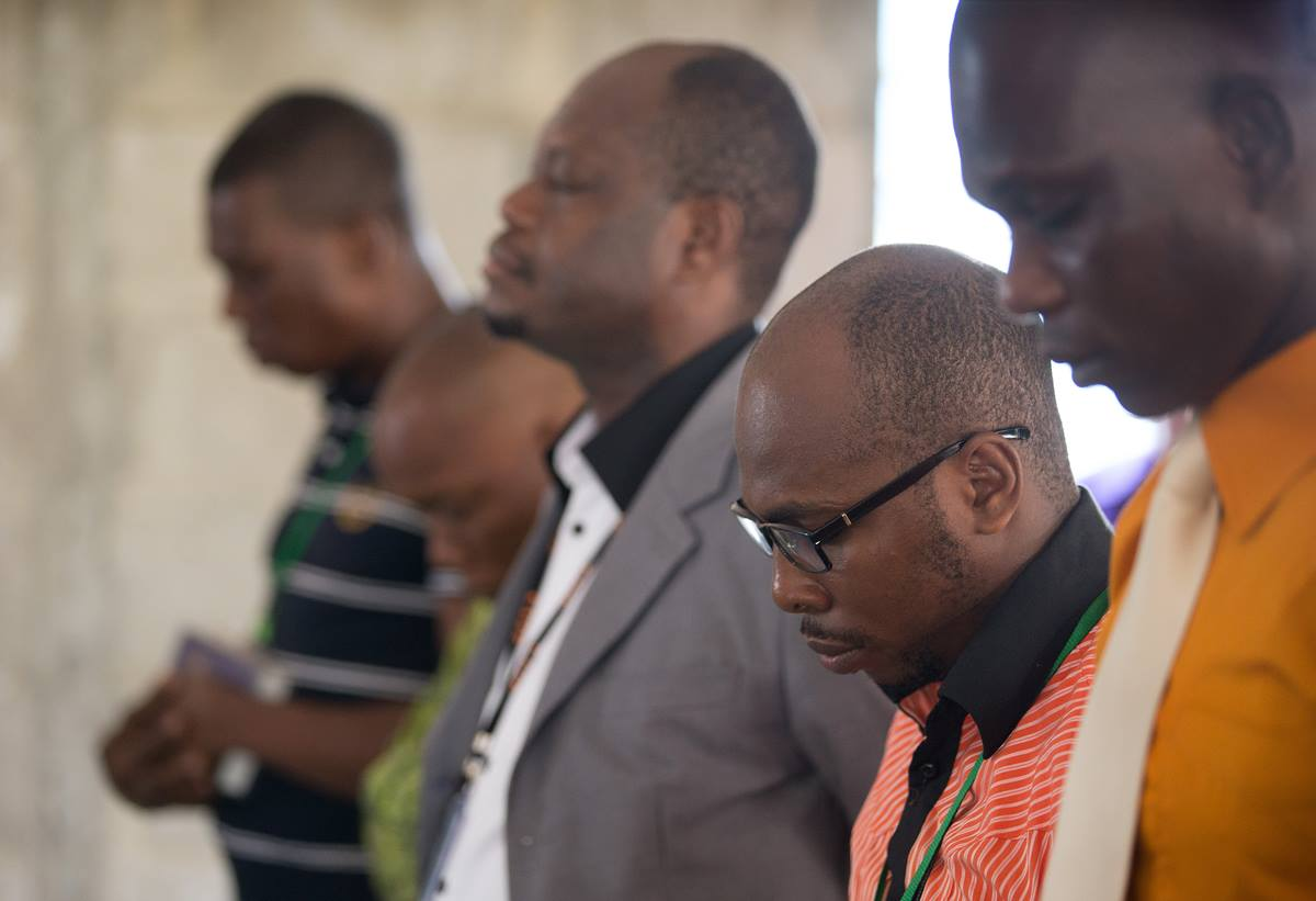 Employees of The United Methodist Church's Voice of Hope radio station in Abidjan, Côte d'Ivoire, pray during a devotional service for station staff. Photo by Mike DuBose, UMNS