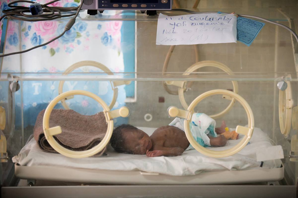 Premature baby Coulibaly Yah Eugenie lies in an incubator at Dabou Methodist Hospital in Dabou, Côte d'Ivoire, hub of the church's healthcare system in this West African nation. The World Health Organization has issued guidelines to improve the immediate care of premature babies in the context of an Ebola outbreak.