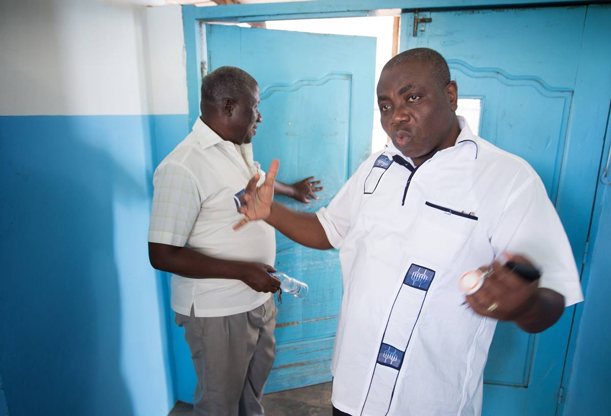 Alfred Degny (right) describes preparations to contain any possible cases of Ebola at Dabou Methodist Hospital. At left is Hyacinthe Bessé, coordinator of the health board of the United Methodist Church of Côte d'Ivoire.
