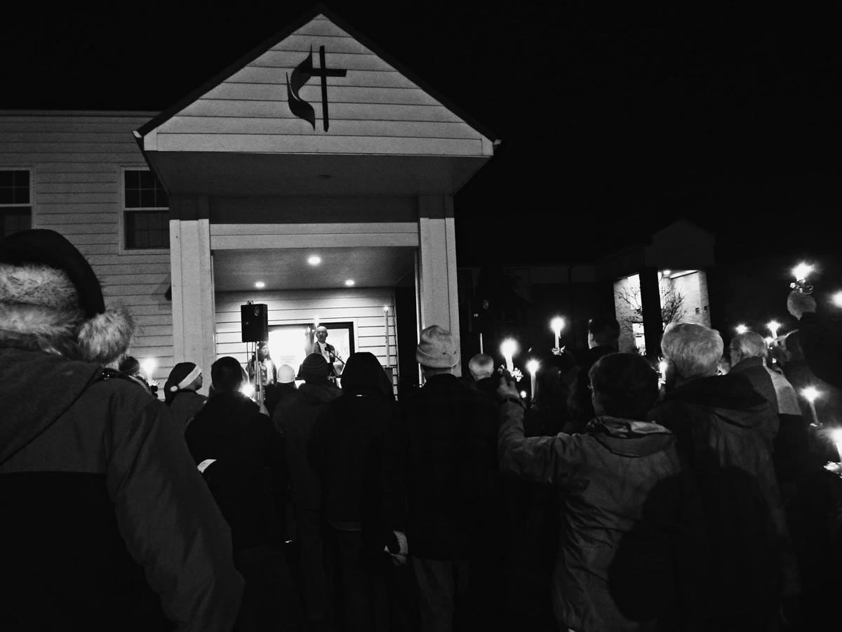 McMinnville Cooperative Ministries, a joint United Methodist-Lutheran church in McMinnville, Oregon, held a candlelight prayer vigil on Dec. 22, after learning the city was seeking to close the homeless encampment at the church. Photo courtesy McMinnville Cooperative Ministries