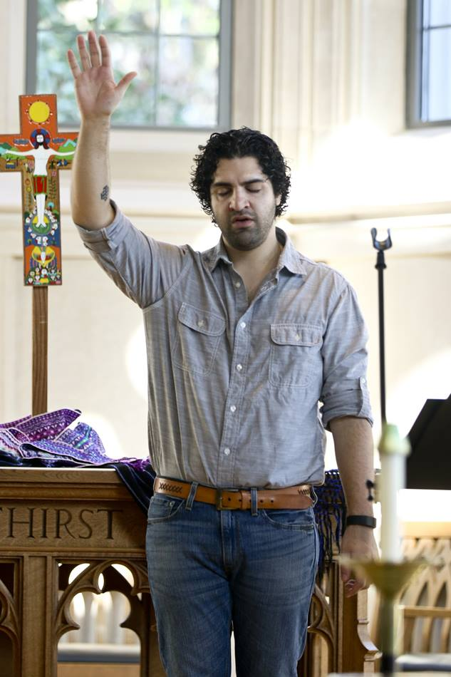 Adrian Federico Apecena, student at Duke Divinity School,  raises his arm in prayer during the third National Consultation on Hispanic/Latino Ministry held at Duke University Divinity School in Durham, N.C. The event took place March 12-14, 2015. Photo by Arthur McClanahan, Iowa Conference