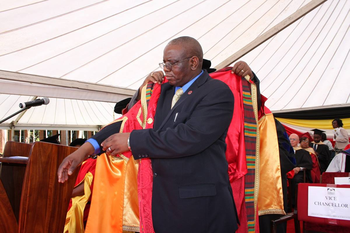 Munashe Furusa is ceremonially robed by Chancellor David Yemba, a United Methodist bishop, during Furusa's inauguration as vice chancellor of Africa University. Photo by Vicki Brown, UMNS