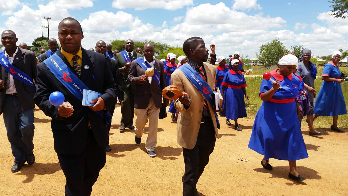 An evangelism team of almost 60 men and women praise and preach evangelism in the Mahusekwa communal area of Zimbabwe.