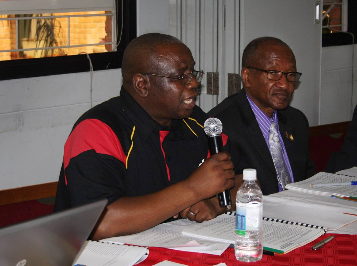 Munashe Furusa, Africa University's new vice chancellor,  reports to the board of directors on issues facing the United Methodist school, including the need for more on need for more faculty with doctorates. Bishop Marcus Matthews, right, listens to the report. Photo by Vicki Brown, UMNS