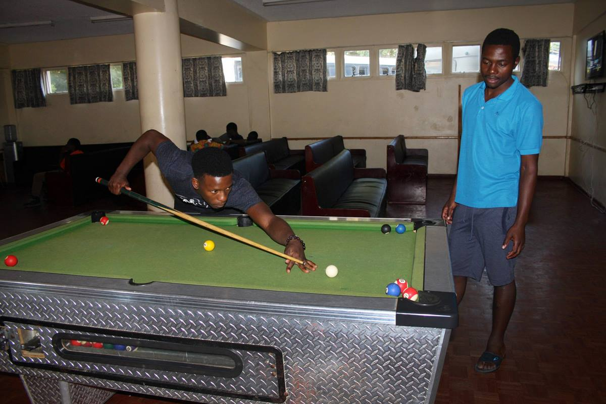 Students play pool in the media room at Africa University. Many students say more social and recreational opportunities for students are needed at the United Methodist university. Photo by Vicki Brown, UMNS