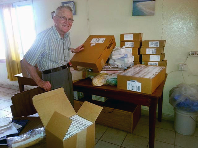 Dr. Lowell Gess unpacks some of the medicines he took to Freetown in January.