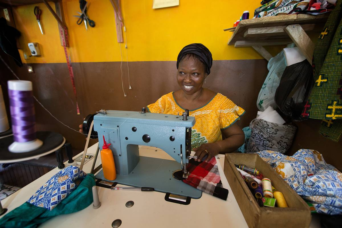 Eugenie Sowan Erse N'Ghessan sews clothes to earning a living for herself and her seven children in Abidjan, Côte d'Ivoire.