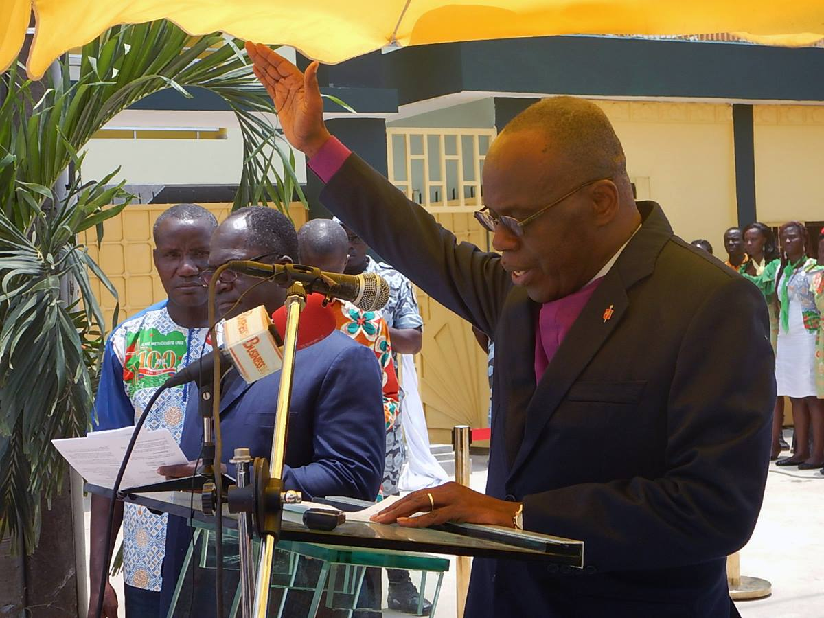 Bishop Benjamin Boni blesses the Côte d'Ivoire United Methodist Church missionary guest house. Photo by Isaac Broune, UMNS