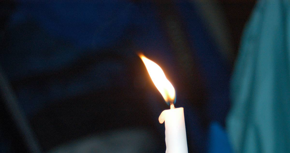 Image of single candle. Photo by Mike DuBose, UMNS.