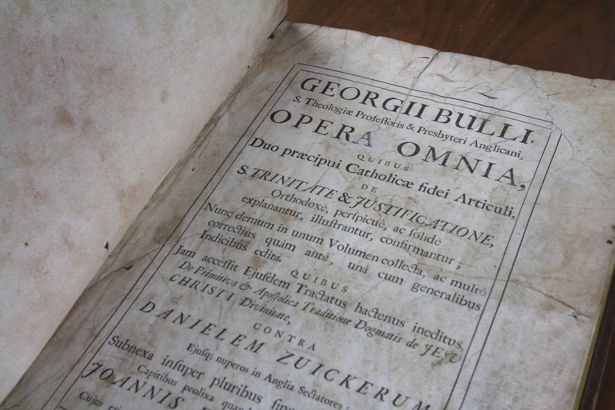 "Rare books from predecessor Methodist publishing operations have ended up at The United Methodist Publishing House in Nashville. This 1703 edition of ""The Works of George Bull"" is one example. Photo by Kathleen Barry, United Methodist Communications"