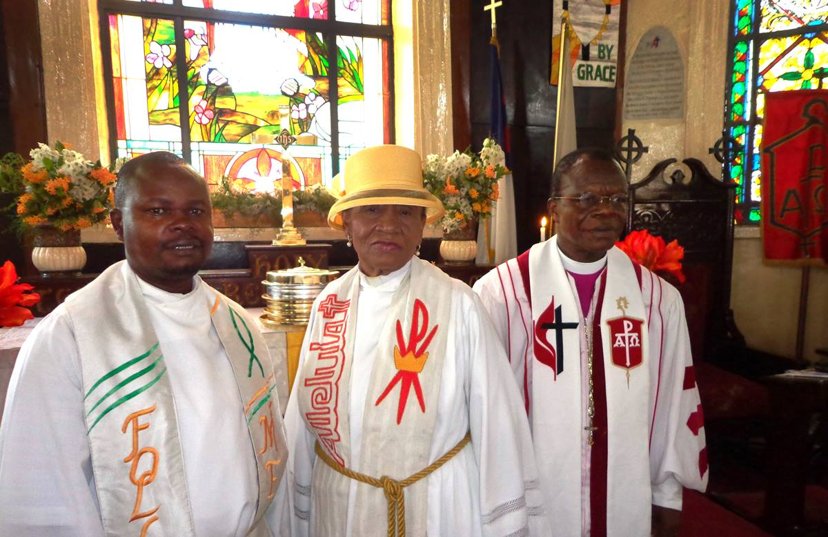 Bishop John G. Innis, right, talked about problems with the proposal to pass legislation making Liberia a Christian nation after he preached at First United Methodist Church Monrovia on Easter Sunday. Also shown are the Rev. Julius Williams, left, associate pastor of the church, and the Rev. Erlene Thompson, pastor of First United Methodist Church Monrovia. Photo by Julu Swen, UMNS