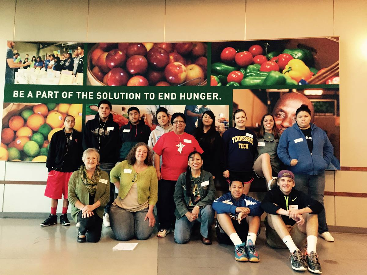 Youth from Clinton Indian United Methodist Church and Community Center in Oklahoma and Providence United Methodist Church, Mount Juliet, Tenn, pose for a picture after sorting 17,700 tons of food at the Second Harvest Food Bank in Nashville, Tenn. Photo by Donna Pewo
