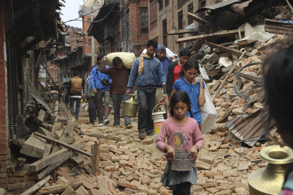 Earthquake survivors carry supplies through the streets of Kathmandu, Nepal. The United Methodist Committee on Relief and other members of ACT Alliance are organizing to provide assistance. Photo courtesy of ACT Alliance