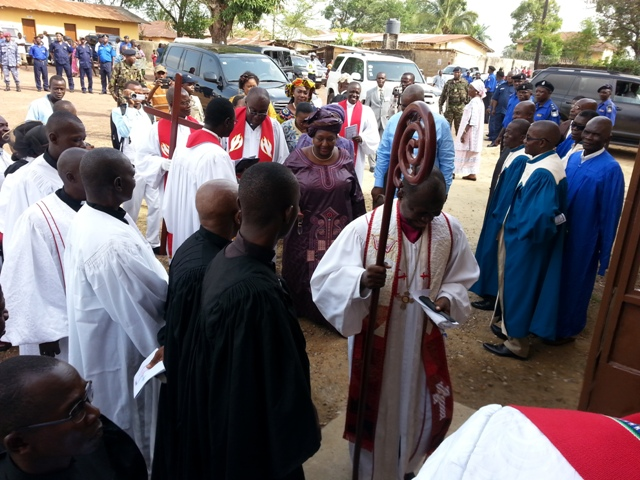 Clergy process into Sierra Leone Annual Conference Sunday service at Rogers Memorial UMC, Bo in southern Sierra Leone. Sierra Leone's First Lady, Sia Nyama Koroma, follows the bishop.