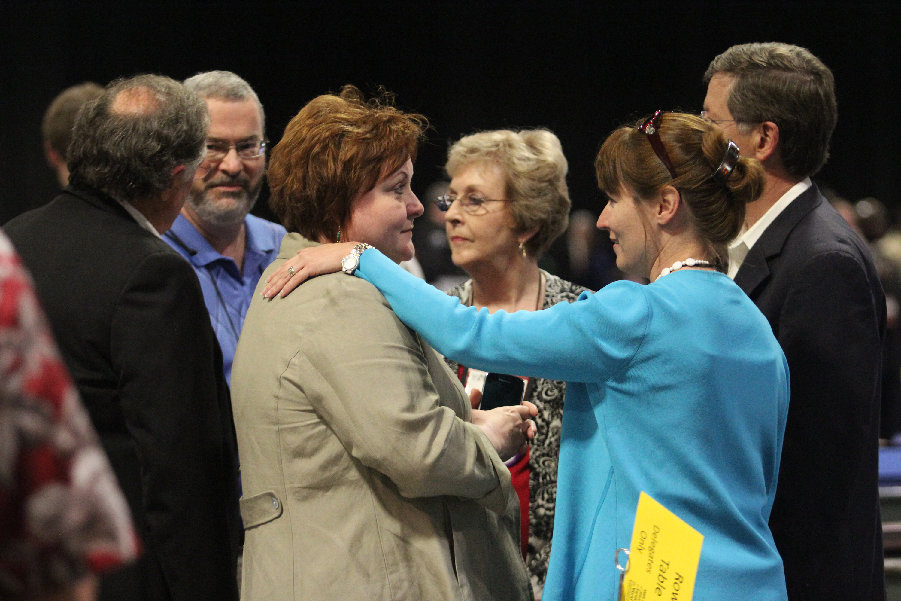 Delegates from the Memphis and Tennessee conferences (from left) David Reed, the Rev. Sky McCracken, Selena Henson, Sandra Burnett, the Rev. Harriett Bryan and the Rev. Randy Cooper, confer with each other at the May 4 plenary of the 2012 United Methodist General Conference in Tampa, Fla. A 2012 file photo by Kathleen Barry, UMNS