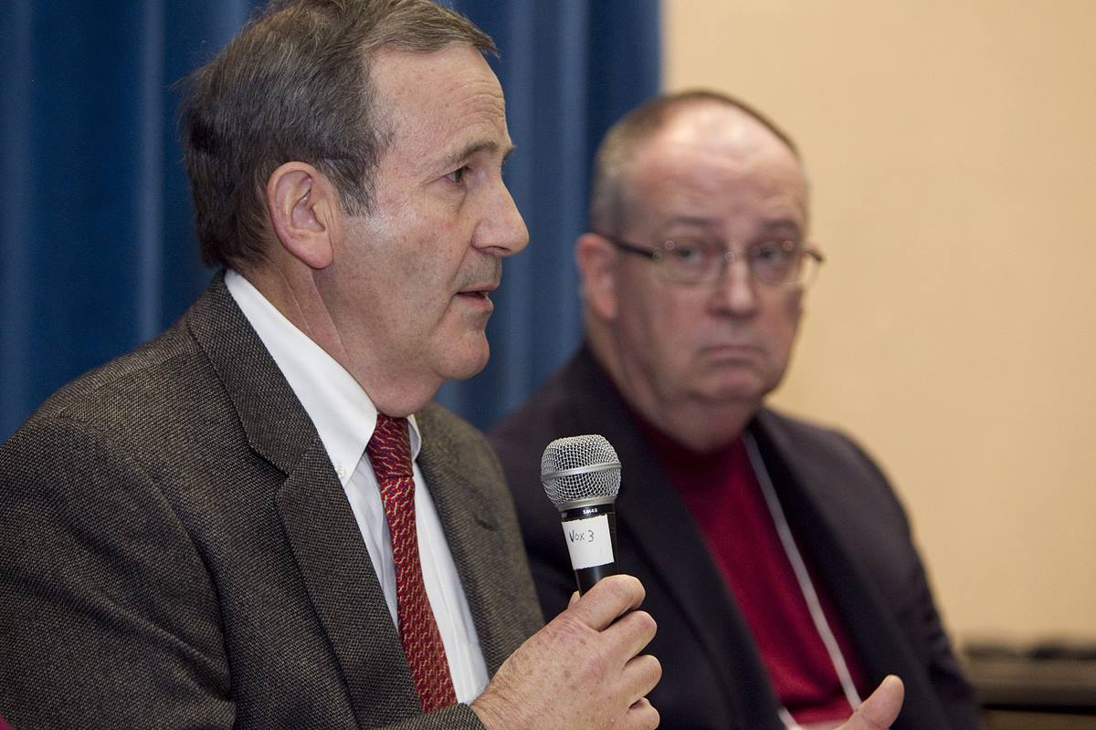 Economist Don House (left) helps lead a discussion about the church budget during the 2012 pre-General Conference news briefing at the Tampa Convention Center in Florida in this file photo. At right is Bishop G. Lindsey Davis. File photo by Mike DuBose, UMNS