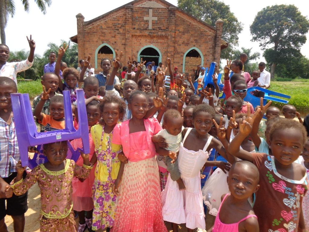 The children of Lokole United Methodist Church in Kindu, Democratic Republic of Congo, after a service. Alfred Zigbuo is visiting churches in the East Congo Episcopal Area to get an idea of what the needs are. Photo courtesy of Alfred Zigbuo