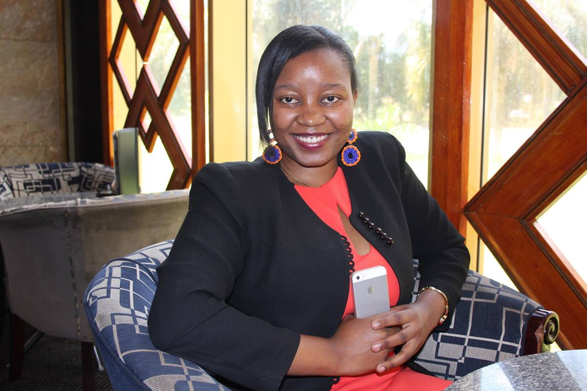 Africa University graduate Chiedza Dziva, along with six friends, is funding scholarships to help children in rural areas pay for primary school. Photo by Vicki Brown, UMNS