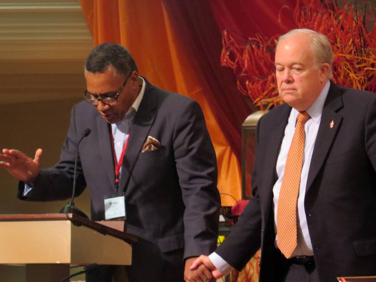 Discussion of a McKinney, Texas police officer's treatment of black youth, captured on a video that went viral, became part of the North Texas Conference annual gathering. The Rev. Michael Bowie, Jr., pastor of St. Luke Community Church in Dallas, joined hands with Bishop Michael McKee on Tuesday, June 9, while leading the conference in prayer about the incident. Photo by Sam Hodges, UMNS