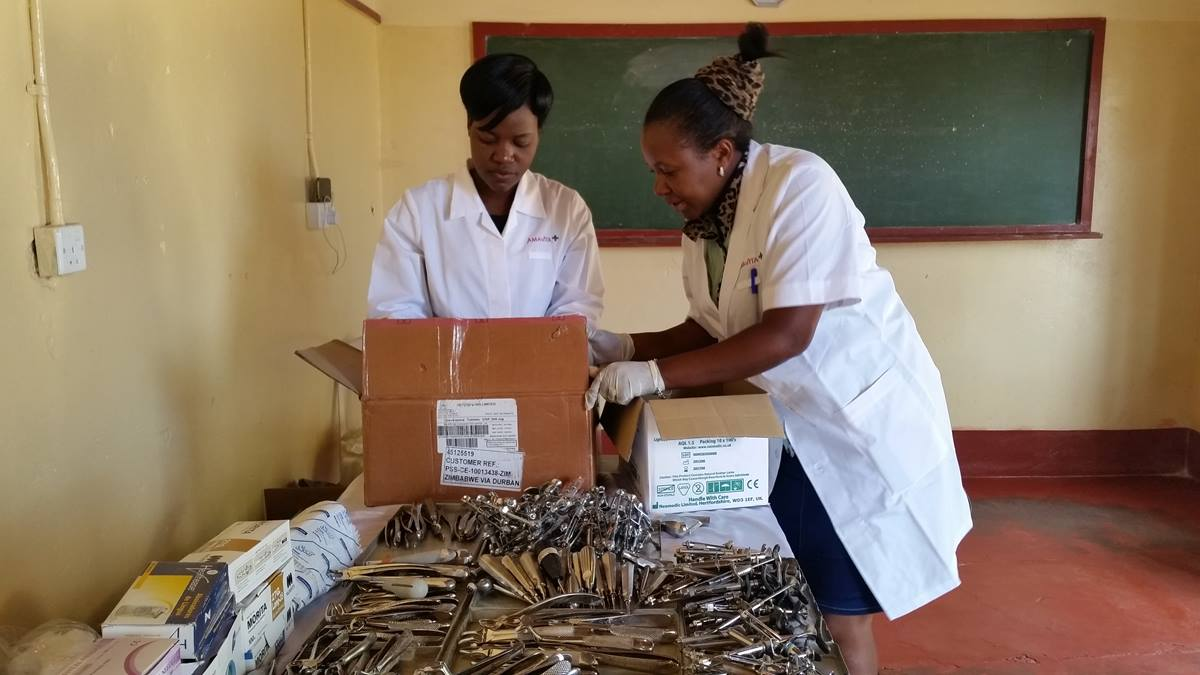 Dental Assistant Pretty Mazura and Dental Outreach Coordinator Sithulisiwe Moyo prepare equipment for the makeshift clinic. Oral examinations and treatment were offered to 80 clients during the cleanup day in Murombedzi, Zimbabwe. Photo by Eveline Chikwanah, UMNS