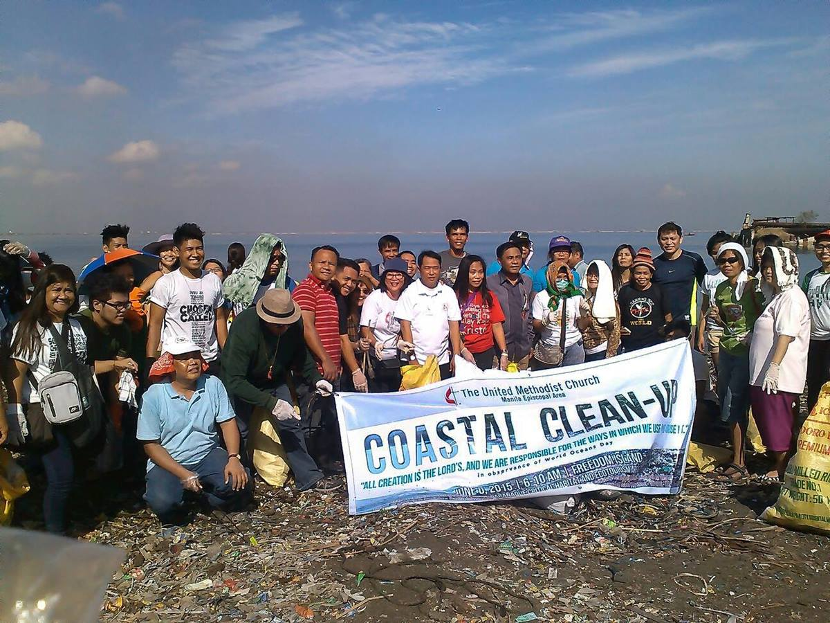 Volunteers from the United Methodist Church cleanup in observance of World Oceans Day.  The cleanup was in coordination with the Save Freedom Island Movement and other groups. Photo courtesy of Glacy Macabale