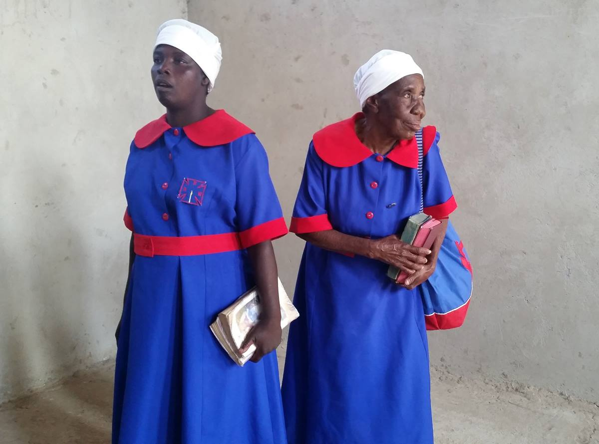 """Winnet Matiza, 76, models The United Methodist Church Zimbabwe uniform with another woman at the inaugural Chitungwiza-Marondera District modeling show.  Matiza, right, was crowned """"queen"""" at the show. Photo by Evelyn Chikwanah, UMNS"""