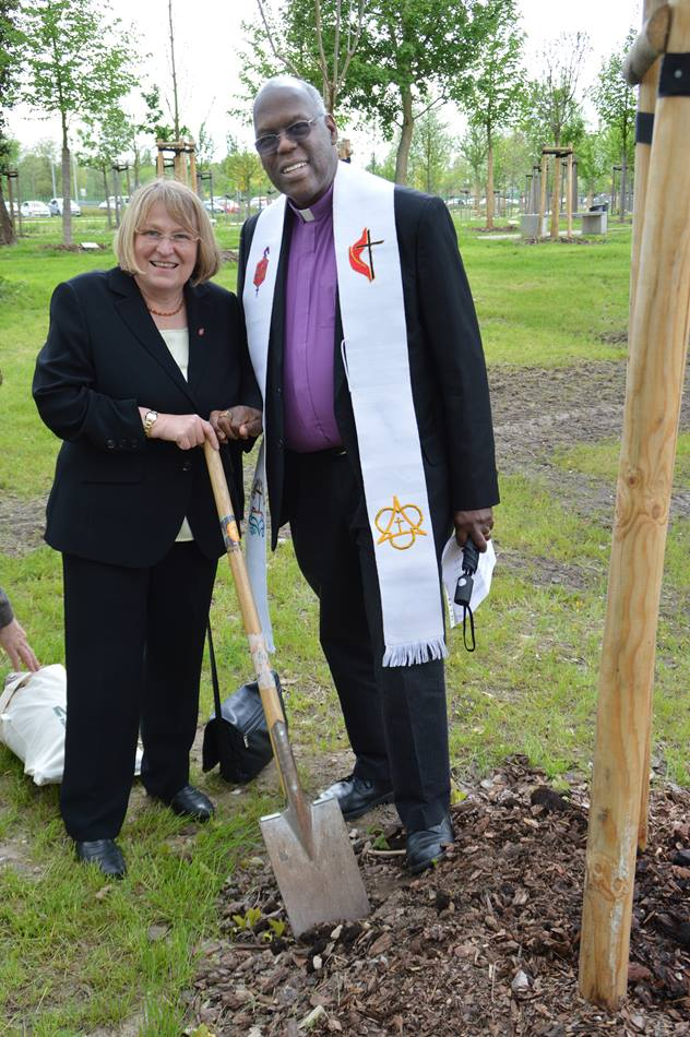 Germany Area Bishop Rosemarie Wenner and San Francisco Area Bishop Warner Brown Jr. join in a tree-planting service on May 9 in Wittenberg, Germany. Photo by Klaus Ulrich Ruof