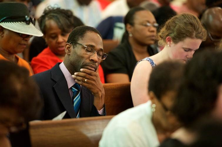 The Rev. Ken Nelson, a United Methodist staff member of the South Carolina Conference, attends a prayer service June 18 at Bethel AME Church in Columbia, S.C. Photo by Matt Brodie, South Carolina Conference