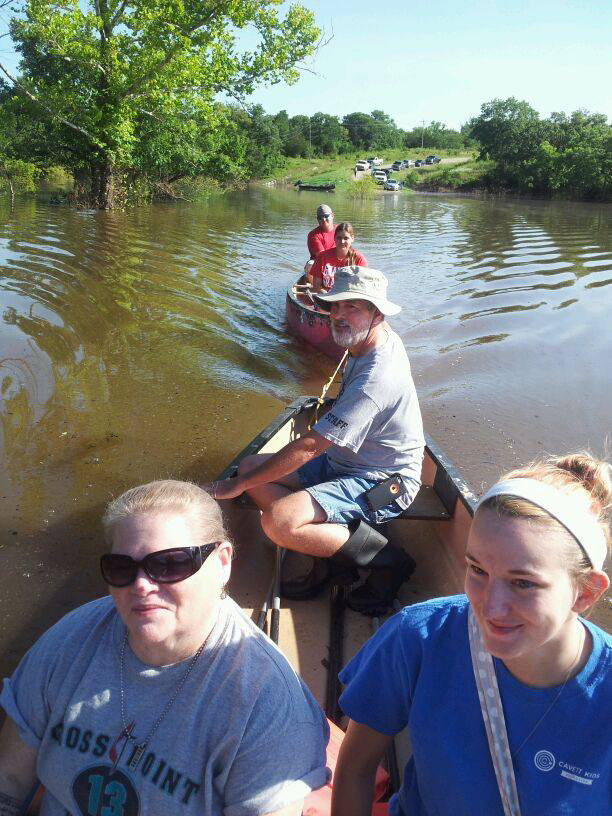 Canoes and other vessels helped get teens to Cross Point United Methodist Camp in Kingston, Okla., on Monday, June 22. Recent floods have cut off road access. Photo courtesy Cross Point Camp