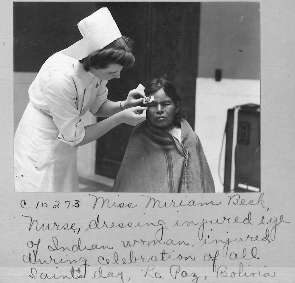 Handwritten captions provide interesting, but often incomplete, details on photos of Methodist mission activity. The caption here names a nurse treating a native woman in La Paz, Bolivia.