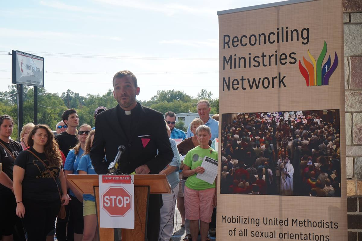 The Rev. Benjamin David Hutchison addresses supporters at a press conference July 28 outside the Michigan Area bishop's office in Lansing, Mich. Hutchison, an African Methodist Episcopal pastor, was forced to resign July 13 from Cassopolis United Methodist Church after the district superintendent received a complaint that the pastor was openly gay and in a relationship. Photo courtesy of Reconciling Ministries Network