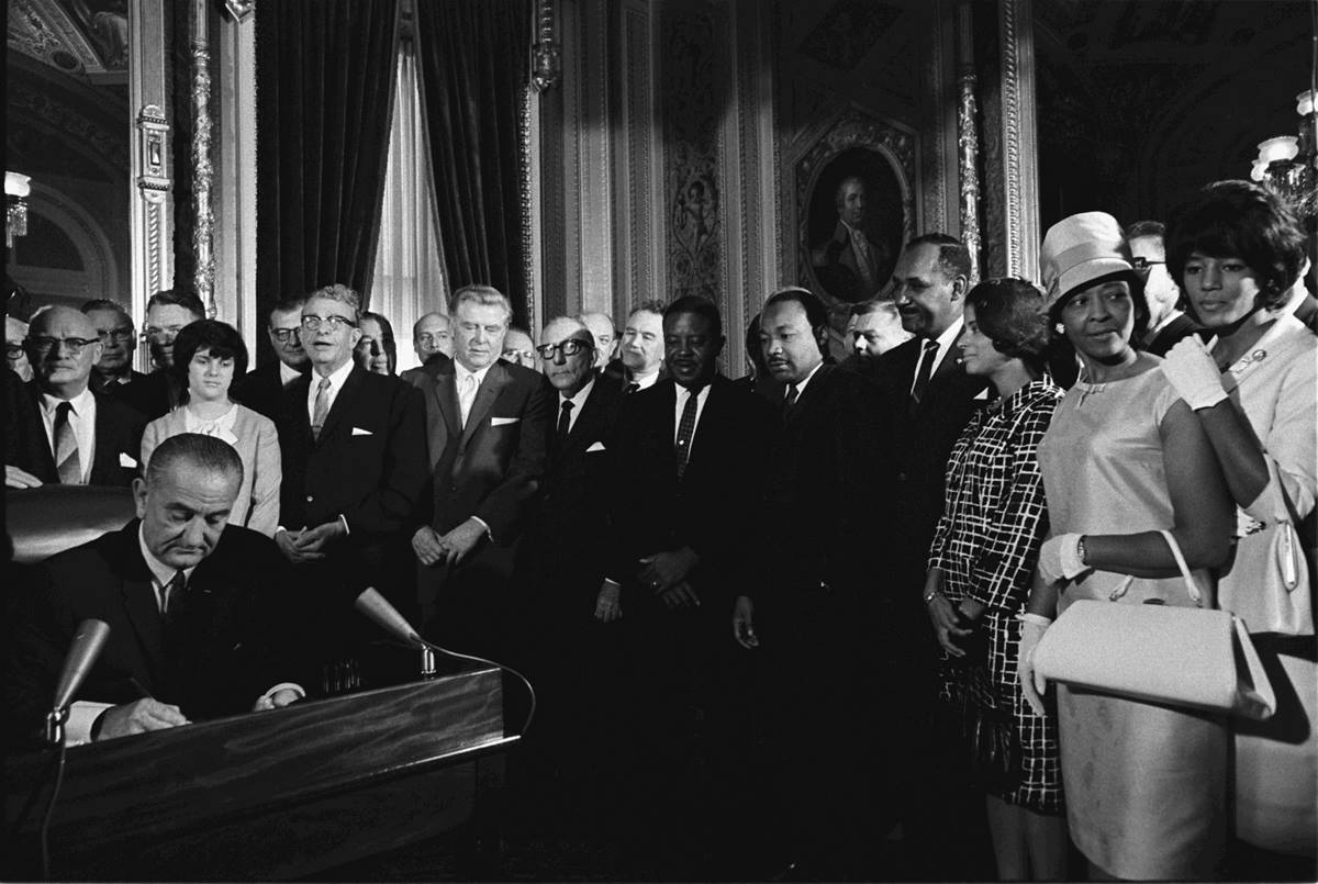 President Lyndon B. Johnson signs the Voting Rights Act of 1965. Photo by Yoichi Okamoto, LBJ Library/Wikimedia Commons